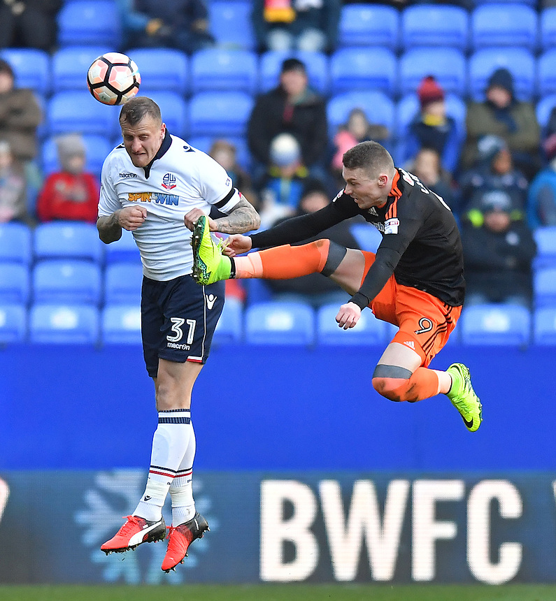 Bolton Wanderers' David Wheater battles with Sheffield United's Caolan Lavery<br /> <br /> Photographer Dave Howarth/CameraSport<br /> <br /> The Emirates FA Cup Second Round - Bolton Wanderers v Sheffield United - Sunday 4th December 2016 - Macron Stadium - Bolton<br />  <br /> World Copyright &copy; 2016 CameraSport. All rights reserved. 43 Linden Ave. Countesthorpe. Leicester. England. LE8 5PG - Tel: +44 (0) 116 277 4147 - admin@camerasport.com - www.camerasport.com