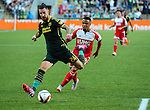 Jun 6, 2015; Portland, OR, USA; Portland Timbers defender Liam Ridgewell (24) goes after a ball as New England Revolution forward Charlie Davies (9) defends during the first half of the game at Providence Park. Mandatory Credit: Steve Dykes-USA TODAY Sports