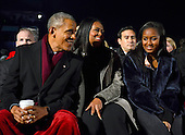 United States President Barack Obama, first lady Michelle Obama, and Sasha Obama listen to the performances as they attend the National Christmas Tree Lighting on the Ellipse in Washington, DC on Thursday, December 1, 2016.<br /> Credit: Ron Sachs / Pool via CNP