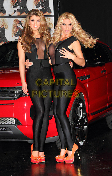 Amy Willerton & Katie Price (Jordan) .Katie Price introduces the winner of her Sky Living TV show 'Signed by Katie Price'- Amy Willerton - at a Photocall at Worx Studio, London, England, UK, .January 19th 2012..full length matching outfit catsuit lycra platform heels shoes  pink orange  arm around sheer cleavage mesh black  see thru through .CAP/ROS.©Steve Ross/Capital Pictures