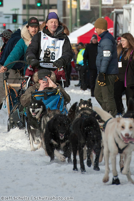 Ketil Reitan and team leave the ceremonial start line with an Iditarider at 4th Avenue and D Street in downtown Anchorage, Alaska on Saturday, March 5th during the 2016 Iditarod race. Photo by Joshua Borough/SchultzPhoto.com
