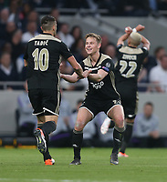 Frenkie de Jong and Dusan Tadic of Ajax celebrate after their first goal scored by Donny van de Beek<br /> <br /> Photographer Rob Newell/CameraSport<br /> <br /> UEFA Champions League - Tottenham Hotspur v Ajax - Tuesday 30th April 2019 - White Hart Lane - London<br />  <br /> World Copyright © 2018 CameraSport. All rights reserved. 43 Linden Ave. Countesthorpe. Leicester. England. LE8 5PG - Tel: +44 (0) 116 277 4147 - admin@camerasport.com - www.camerasport.com