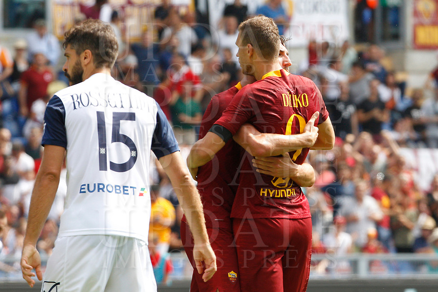 Roma's Bryan Cristante, center, is hugged by his teammate Edin Dzeko after scoring as Chievo Verona's Luca Rossettini, left, reacts during the Italian Serie A football match between Roma and Chievo Verona at Rome's Olympic stadium, September 16, 2018.<br /> UPDATE IMAGES PRESS/Riccardo De Luca