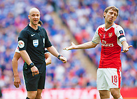 Nacho Monreal  of Arsenal gestures to referee Anthony Taylor during the FA Cup Final match between Arsenal v Chelsea, Wembley stadium, London on 27th May 2017