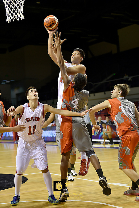 Action from the FIBA Oceania Under 16s Championship Tournament - Bronze Medal Game New Caledonia v Tahiti at TSB Arena, Wellington, New Zealand on Tuesday 18 August 2015.<br /> Photo by Masanori Udagawa. <br /> www.photowellington.photoshelter.com.