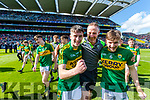 Chris O'Donoghue, Tommy Griffin trainer and Michael Potts Kerry Minors celebrate with the Tom Markham Cup after defeating Derry in the All-Ireland Minor Footballl Final in Croke Park on Sunday.