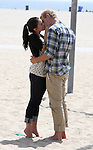 8-19-09....Jessica Lowndes  kissing Trevor Donovan on the beach in Santa Monica California. Jessica was doing most of her own makeup putting on lipstick in between scenes. Trevor got some lipstick on his teeth & had some trouble wiping it off whith a white napkin...AbilityFilms@yahoo.com.805-427-3519.www.AbilityFilms.com.