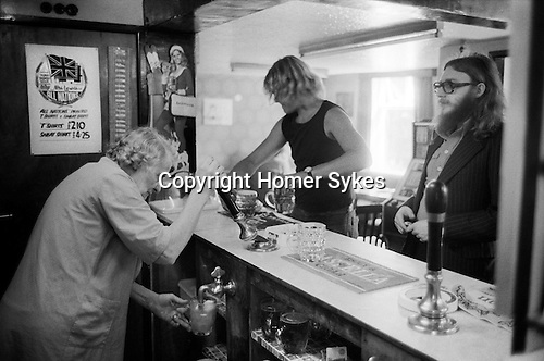 All Nation Inn Madeley Shropshire UK 1978. Homebrew pub, landlady pulling a pint.