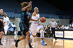 21 November 2013: North Carolina's Allisha Gray (right) drives against Coastal Carolina's Alexx Puckett (25). The University of North Carolina Tar Heels played the Coastal Carolina University Chanticleers in an NCAA Division I women's basketball game at Carmichael Arena in Chapel Hill, North Carolina. UNC won the game 106-52.