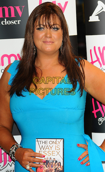 "Gemma Collins  .Signing copies of the new ""The Only Way is Essex"" DVD, HMV, Westfield, Stratford, East London, England..29th September 2011.TOWIE half length blue turquoise dress.CAP/CJ.©Chris Joseph/Capital Pictures."