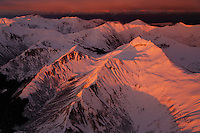 Aerial photographs of South Chilkat Mountains basking in warm evening light in Southeast Alaska.