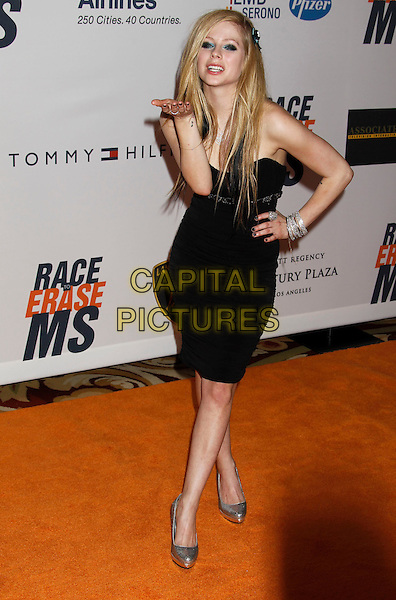 AVRIL LAVIGNE .17th Annual Race To Erase MS. Held at the Hyatt Regency Century Plaza Hotel,   Century City, California, USA, .May 7th 2010..full length dress sleeveless hand on hip black blowing kiss gesture silver shoes shiny sparkly bracelets bangles .CAP/ADM/MJ.©Michael Jade/AdMedia/Capital Pictures.