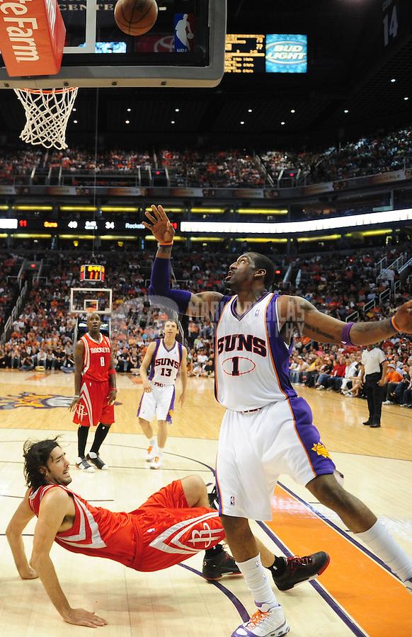Mar. 22, 2008; Phoenix, AZ, USA; Phoenix Suns center (1) Amare Stoudemire drives to the hoop as Houston Rockets forward (4) Luis Scola falls at the US Airways Center. Mandatory Credit: Mark J. Rebilas