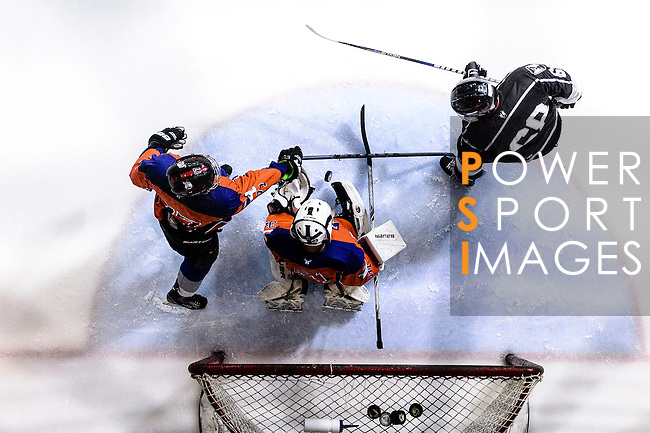 Principal Team Goalie #31 Matthew Young (c) makes a save on Gaggia Empire Skater #68 Norm Chin (r) during the Principal Standard League match between Principal vs Gaggia Empire at the Mega Ice on 24 January 2017 in Hong Kong, China. Photo by Marcio Rodrigo Machado / Power Sport Images