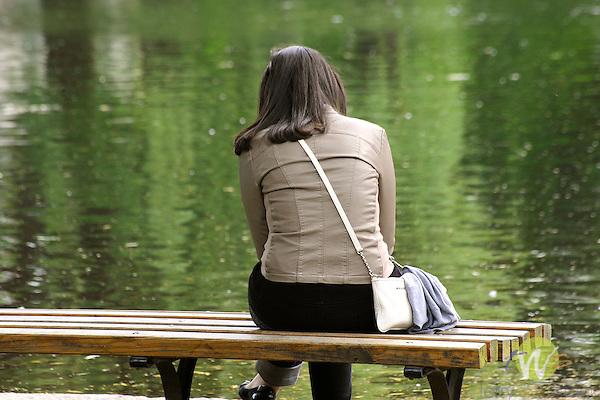 Boston Public Garden. Woman alone on park bench