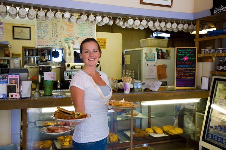Grandma's Coffee House in Keokea, Maui, Hawaii has been roasting it's own coffee since 1918.  Pictrued here is manager Amber Coleman delivering breakfast.