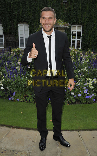 LONDON, ENGLAND - AUGUST 28: Lukas Podolski attends the Mo Farah Foundation &quot;A Night Of Champions&quot; Dinner, The Hurlingham Club, Ranelagh Gardens, on Thursday August 28, 2014 in London, England, UK. <br /> CAP/CAN<br /> &copy;Can Nguyen/Capital Pictures