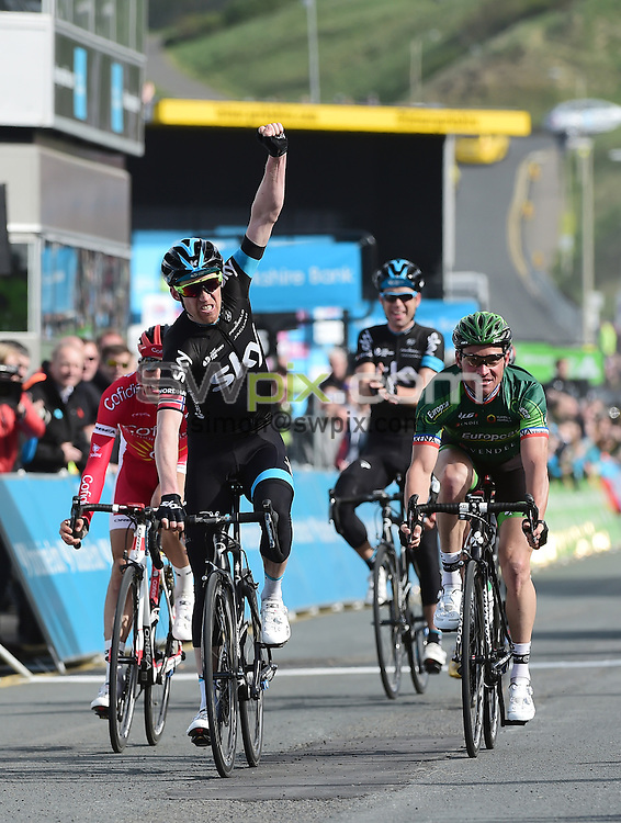 Picture by Alex Broadway/SWpix.com - 01/05/2015 - Cycling - 2015 Tour de Yorkshire: Stage 1, Bridlington to Scarborough - Lars Petter Nordhaug of Team Sky crosses the finish line in first place to win Stage 1 in Scarborough.
