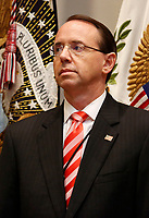 United States Deputy Attorney General Rod Rosenstein looks on during the signing ceremony for S. 2553 &quot;Know the Lowest Price Act&quot; and S. 2554 &quot;Patients Right to Know Drug Prices Act&quot;, in the Roosevelt Room of the White House, Washington, DC, October 10, 2018.<br /> CAP/MPI/RS<br /> &copy;RS/MPI/Capital Pictures