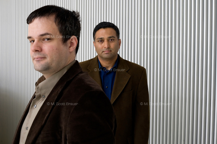 Dr. Andreas Velten, Postdoctoral Associate, (left) and Dr. Ramesh Raskar pose in the MIT Media Lab, where they work as part of the Media Lab Camera Culture group, at MIT in Cambridge, Massachusetts, USA.  Velten and Raskar's group has developed a camera that records at 1 trillion frames per second, which allows, for example, the recording of pulses of light moving through a liquid.