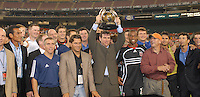 Former DC United defender Jeff Agoos lifts the first MLS Cup trophy, surrounded by members of the 1996 DC United championship team and current DC teammates, during a pregame ceremony for MLS's 10th anniversary. DC United defeated the New York Red Bulls 4-3. DC has earned the top seed in the 2006 MLS Playoffs and will enjoy home field advantage for the entire Eastern Conference Playoffs.  Saturday, September 23, 2006, at RFK Stadium .