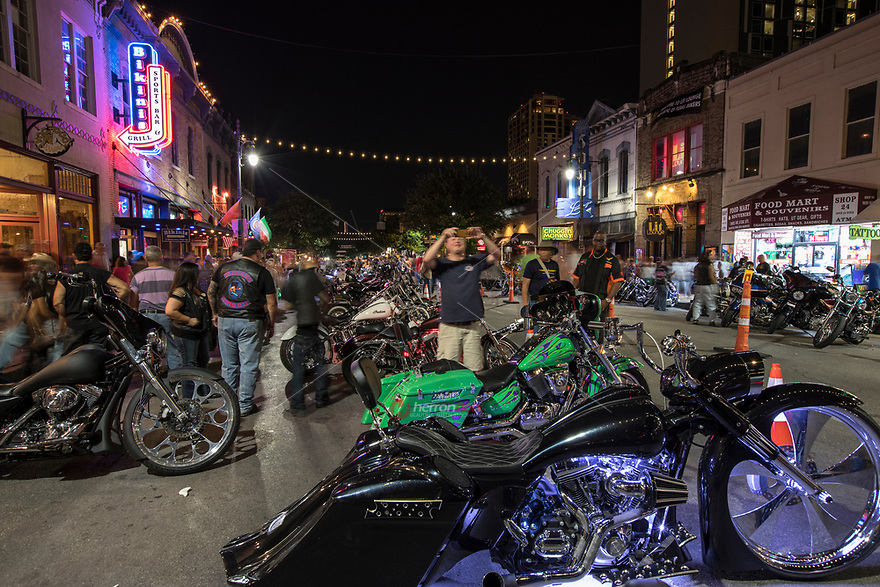 Motorcycle bikers and enthusiasts from all over the world come to take pictures of the thousands of custom motorcycles or Hogs parked along the 6th Street Bar District in downtown Austin, Texas.