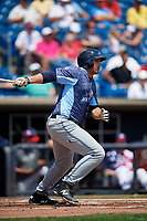 West Michigan Whitecaps first baseman Reynaldo Rivera (14) follows through on a swing during a game against the Quad Cities River Bandits on July 23, 2018 at Modern Woodmen Park in Davenport, Iowa.  Quad Cities defeated West Michigan 7-4.  (Mike Janes/Four Seam Images)