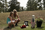 Saturday, August 8, Aberdeen, NC..A memorial service was held for Brent Gray, a former special forces soldier and private contractor killed in Iraq on August 18, 2006, at Bethesda Cemetery. After the cemetery, the memorial was continued at a favorite bar of Mr. Gray in nearby Southern Pines.. Randi Gray, Mr. Gray's  sister and organizer of the memorial, and her daughter Kensie at the grave of Brent Gray.