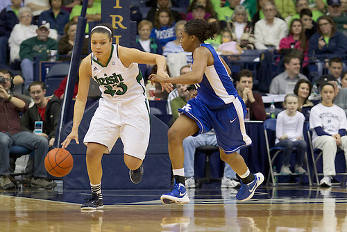 Notre Dame guard Kayla McBride (#23) dribbles the ball as Kentucky guard Bria Goss (#13) defends in second half action during NCAA Women's basketball game between Kentucky and Notre Dame.  The Notre Dame Fighting Irish defeated the Kentucky Wildcats 92-83 in game at Purcell Pavilion at the Joyce Center in South Bend, Indiana.