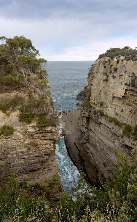 The 60 metres deep Devil's Kitchen has been formed by a similar process to that which has created Tasman's Arch - by the collapse of a sea cave