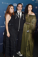 LOS ANGELES, CA - JANUARY 05: (L-R) Summer Phoenix, Joaquin Phoenix and Rain Phoenix attend Michael Muller's HEAVEN, presented by The Art of Elysium at a private venue on January 5, 2019 in Los Angeles, California.<br /> CAP/ROT/TM<br /> &copy;TM/ROT/Capital Pictures