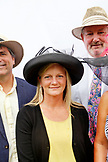 USA, Tennessee, Nashville, Iroquois Steeplechase, spectators pose for a portrait on race day near the society tent