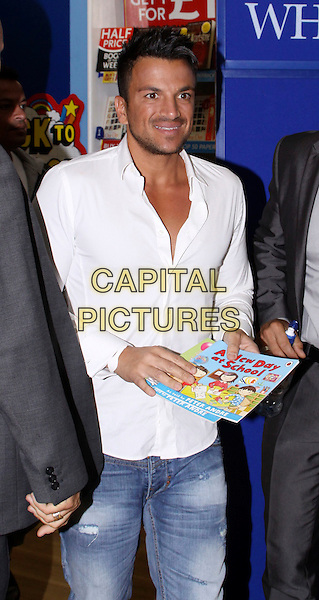 "Peter Andre at WH Smith signing copies of his new children's books, ""The Happy Birthday Party"" and ""A New Day at School"", Milton Keynes, England..September 5th, 2011.book booksigning half length white shirt jeans denim.CAP/COA/CC.©CC/COA/Capital ."