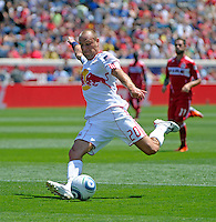 New York midfielder Joel Lindpere (20) unleashes a shot.  The Chicago Fire tied the New York Red Bulls 1-1 at Toyota Park in Bridgeview, IL on June 26, 2011.