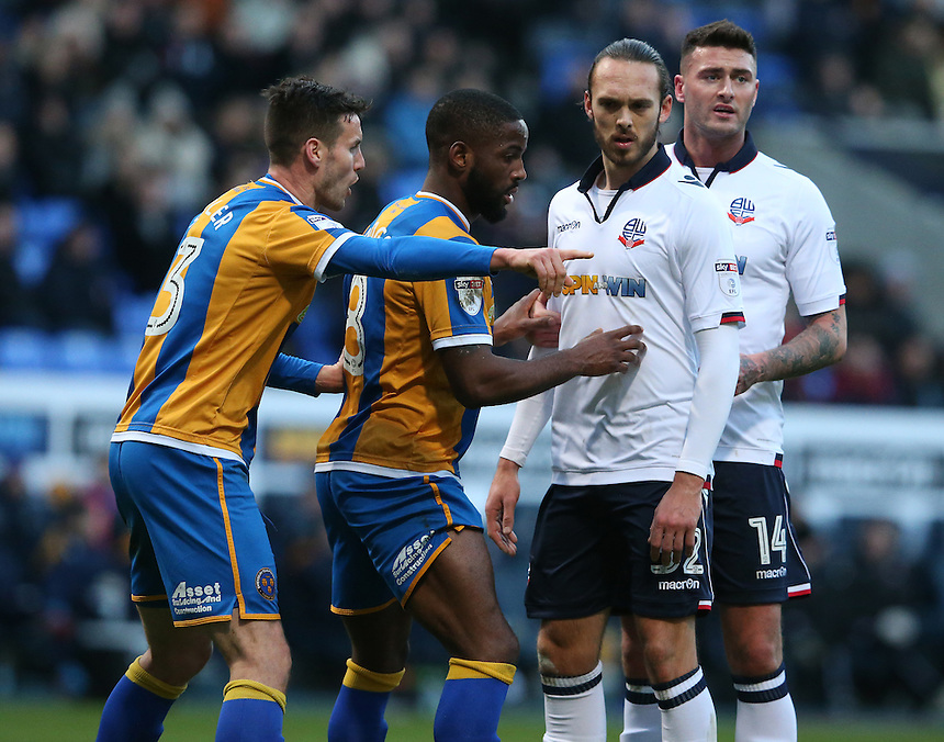 Bolton Wanderers' Tom Thorpe and Gary Madine (right) closely marked by Shrewsbury Town's Matthew Sadler (left) and Abu Ogogo as they wait for a corner kick<br /> <br /> Photographer Stephen White/CameraSport<br /> <br /> The EFL Sky Bet League One - Bolton Wanderers v Shrewsbury Town - Monday 26th December 2016 - Macron Stadium - Bolton<br /> <br /> World Copyright &copy; 2016 CameraSport. All rights reserved. 43 Linden Ave. Countesthorpe. Leicester. England. LE8 5PG - Tel: +44 (0) 116 277 4147 - admin@camerasport.com - www.camerasport.com