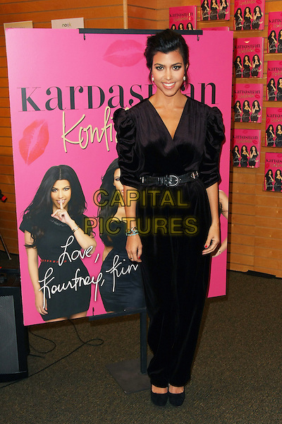 "KOURTNEY KARDASHIAN .""Kardashian Konfidential"" Book Signing held at at Barnes & Noble, Santa Monica, California, USA, .8th February 2011..full length velvet jumpsuit catsuit belt smiling bracelets  ruched puff shoulders sleeves .CAP/ADM/TB.©Tommaso Boddi/AdMedia/Capital Pictures."