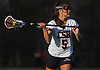 Sophia DeRosa #5 of Cold Spring Harbor looks to pass from behind the net during a Nassau County varsity girls lacrosse game against Long Beach at Cold Spring Harbor High School on Wednesday, April 18, 2018. She tallied five goals and three assists in Cold Spring Harbor's 13-2 win.