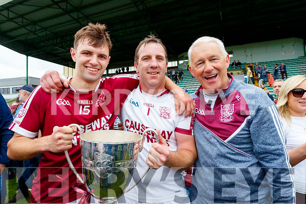 Three generations of Causeway greats! Gavin Dooley pictured with his father John Mike Dooley and his grandfather Maurice Leahy and the Neilus Flynn Cup after Causeway's Senior Hurling Championship win on Sunday.