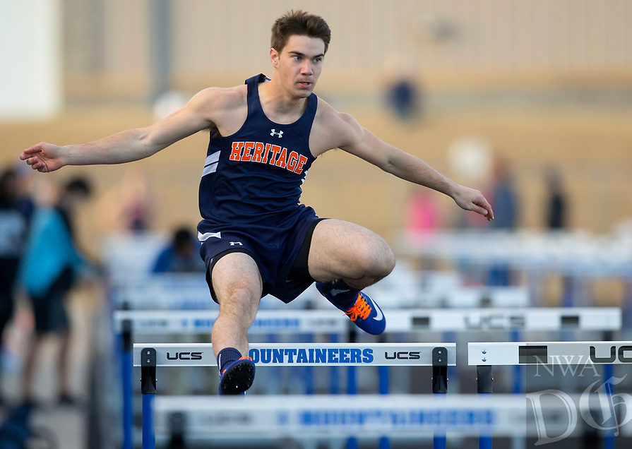 NWA Democrat-Gazette/JASON IVESTER<br /> Rogers Heritage sophomore Zack Walkup competes in the shuttle hurdle relay Friday, March 10, 2017, during the Whitey Smith Relays at Rogers High School.