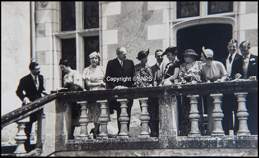 BNPS.co.uk (01202 558833)<br /> Pic: PhilYeomans/BNPS<br /> <br /> Edward and Wallis emerge onto the upper terrace after the ceremony. the few guests included Baron Eugene Rothschild and Randolph Churchill.<br /> <br /> Previously unseen photographs of the most notorious wedding of the twentieth century have come to light - in a secret album only distributed to the small number of guest's.<br /> <br /> The series of candid photographs from the marriage of Edward VIII to his mistress Wallis Simpson in June 1937 have come to light 80 years after the he sparked a constitutional crisis in Britain.<br /> <br /> The intimate photos were taken by Lady Alexandra Metcalfe, wife of Edward's best man Major Edward 'Fruity' Metcalfe, who had assumed the role of unofficial photographer at the simple ceremony.<br /> <br /> The private pictures were distributed only to the handful of guest's at the Chateau, and this set was given to W. Cunningham Graham, the British consul at Nante.<br /> <br /> They show how Edward's marriage to Wallis Simpson was in stark contrast to the opulent weddings that Royal Family members are usually afforded.<br /> <br /> Bellmans auctioneers in Billingshurst, West Sussex are selling the fascinating album on 30th November.