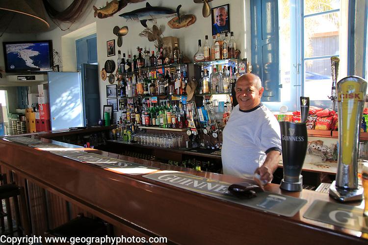 Barman inside Gleneagles Bar pub at Mgarr, Gozo, Malta