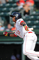 Third baseman Rafael Devers (13) of the Greenville Drive bats in a game against the Savannah Sand Gnats on Sunday, July 5, 2015, at Fluor Field at the West End in Greenville, South Carolina. Devers is the No. 6 prospect of the Boston Red Sox, according to Baseball America. Savannah won, 8-6. (Tom Priddy/Four Seam Images)