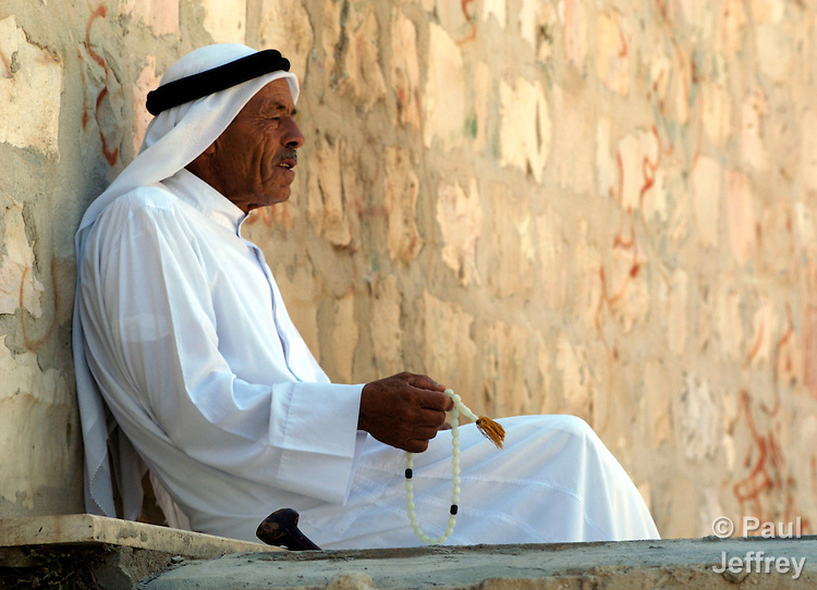 A Muslim man and his prayer beads in the small West Bank village of Aboud.