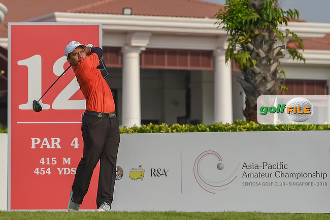 Muhammad Afif FATHI (MAS) watches his tee shot on 12 during Rd 2 of the Asia-Pacific Amateur Championship, Sentosa Golf Club, Singapore. 10/5/2018.<br /> Picture: Golffile   Ken Murray<br /> <br /> <br /> All photo usage must carry mandatory copyright credit (© Golffile   Ken Murray)