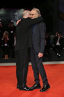 "VENICE, ITALY - SEPTEMBER 05: Roberto Saviano and Adriano Chiaramida walk the red carpet of the ""ZeroZeroZero"" screening during the 76th Venice Film Festival at Sala Grande on September 05, 2019 in Venice, Italy. (Photo by Mark Cape/Insidefoto)<br /> Venezia 05/09/2019"