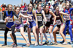 RAPID CITY, SD - MAY 30: Runners wait for a handoff in the girls class B medley relay during the 2015 SDHSAA State Track & Field Meet Saturday at O'Harra Stadium in Rapid City, S.D. (Photo by Dick Carlson/Inertia)