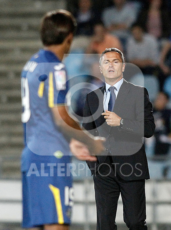 Getafe's coach Fran Escriba with his player Damian Suarez during La Liga match.September 18,2015. (ALTERPHOTOS/Acero)