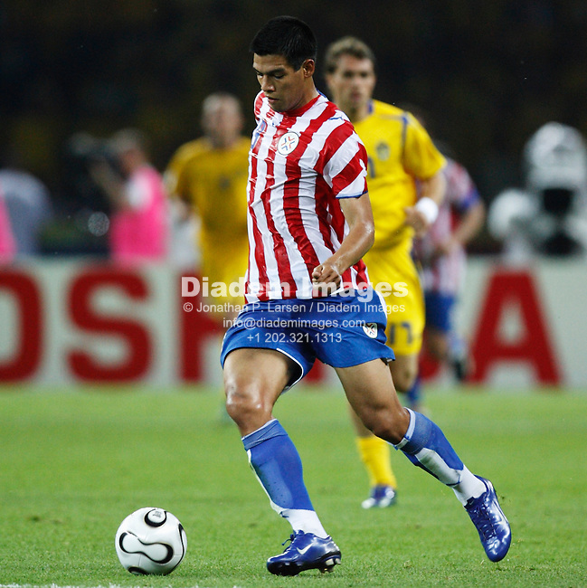 BERLIN - JUNE 15:  Julio Dos Santos of Paraguay in action during a 2006 FIFA World Cup soccer match against Sweden June 15, 2006 in Berlin, Germany.  (Photograph by Jonathan P. Larsen)
