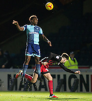 Anthony Stewart of Wycombe Wanderers wins the ball in the air during the The Checkatrade Trophy Southern Group D match between Wycombe Wanderers and Coventry City at Adams Park, High Wycombe, England on 9 November 2016. Photo by Andy Rowland.