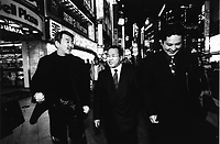 Former Yakuza, Japanese gangstars, became Christian missionaries walking in the street of Kabukicho, Shinjuku, Tokyo, Japan